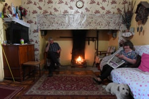 Michael and Theresa McDermott sit by the fire in their farmhouse which overlooks U.S. President Donald Trump's Doonbeg Golf course in Doonbeg, Ireland