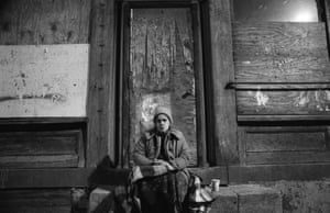 A homeless woman in front of an abandoned buildingIn Fells Point, Baltimore's waterside bar district. This location is now a juice bar