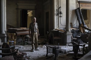 Roderick Sursock stands in a heavily damaged room at the palace