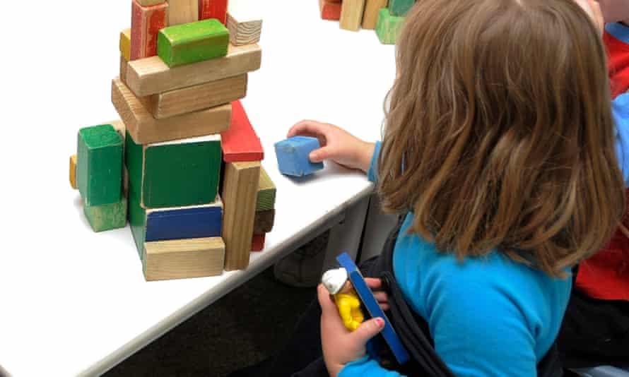 Child plays with blocks