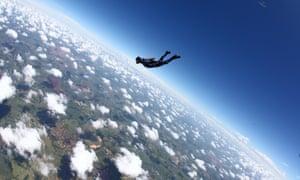 Skydiving over mountain. Photograph: Rick Neves/Getty Images
