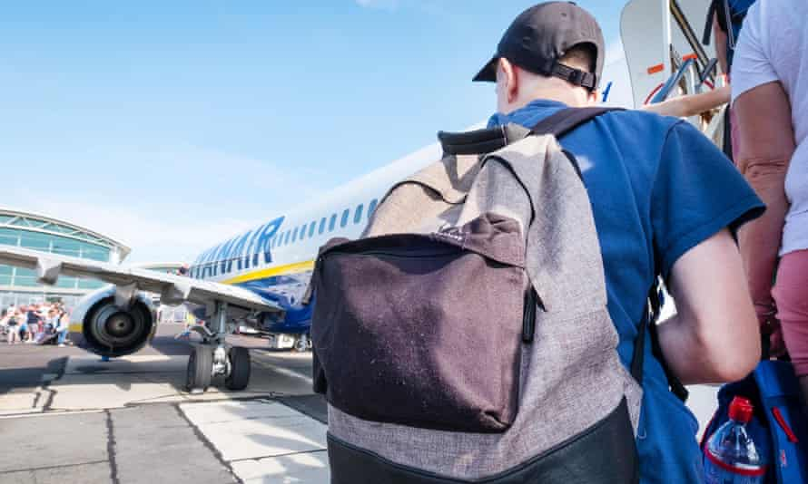 Passenger with a backpack boarding a Ryanair plane
