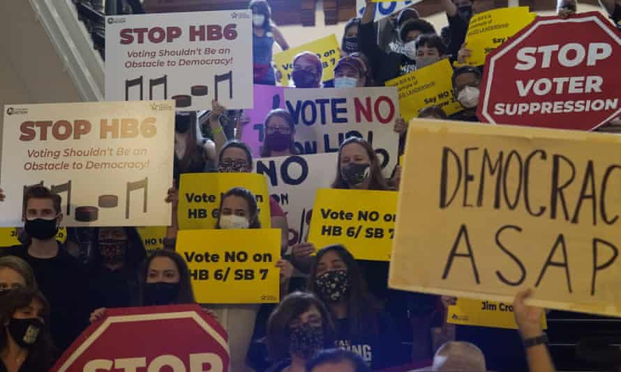 A group opposing new voter legislation gathers outside the house chamber at the Texas capitol in Austin.
