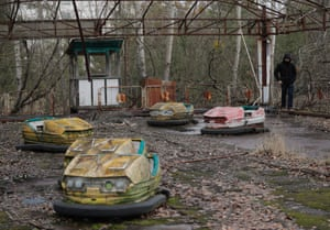 Rusting bumper cars in the deserted city of Pripyat