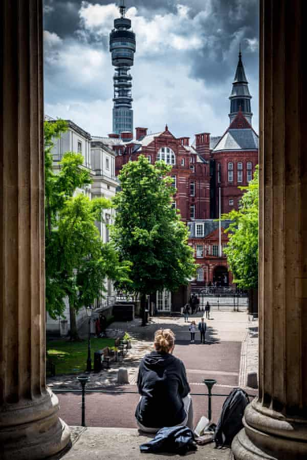 A student looking towards UCL's Cruciform Building, the BT Tower and Fitzrovia.