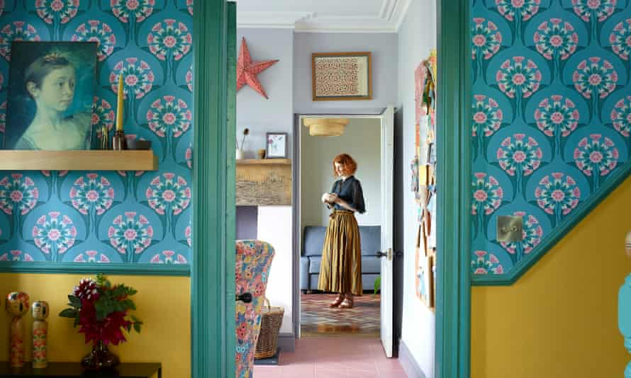 Blue patterned wallpaper and mustard yellow in the hallway