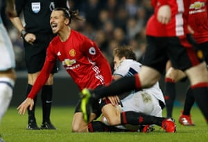 West Bromwich Albion's Craig Dawson fouls Manchester United's Zlatan Ibrahimovic and is shown a yellow card.
