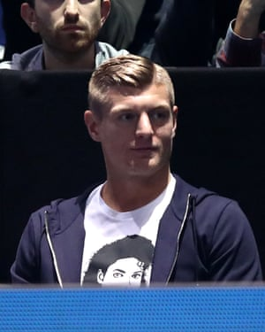 Toni Kroos watches on.