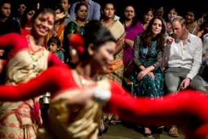 The pair watch dancers performing during the Bihu festival