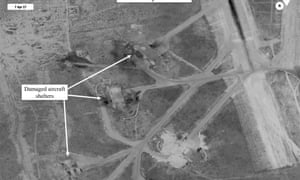 A handout photo made available by Office of the Secretary of Defense shows a battle damage assessment image of the Shayrat airbase.