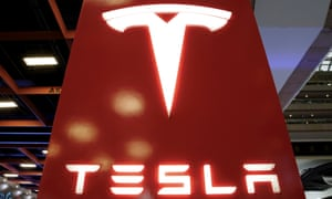 Tesla shares rose in after-hours trading despite the loss.