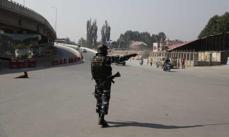 A member of the paramilitary at Jehangir Chowk, a normally busy crossroads in central Srinagar.