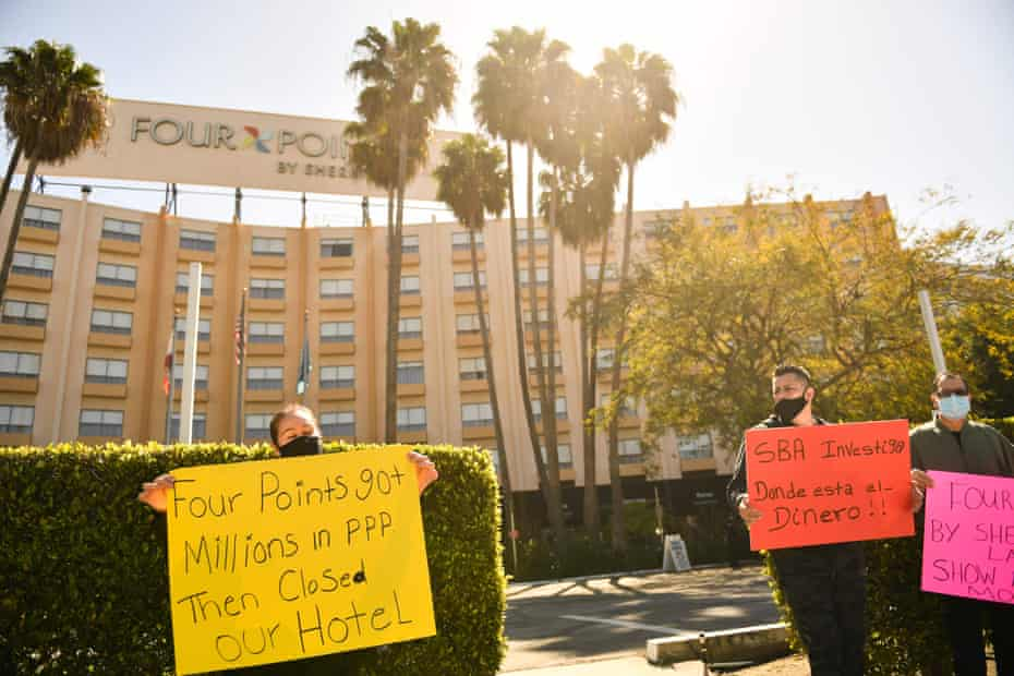 Laid-off employees and workers with Unite Here 11 protest outside the closed Four Points by Sheraton LAX hotel.