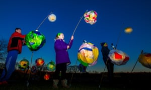 Kids with colourful lanterns on procession at Aysgarth Falls, Yorkshire Dales