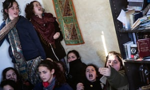 Teenage supporters of the Amona settlers inside one of the houses slated for demolition during the eviction of the illegal outpost on Wednesday.