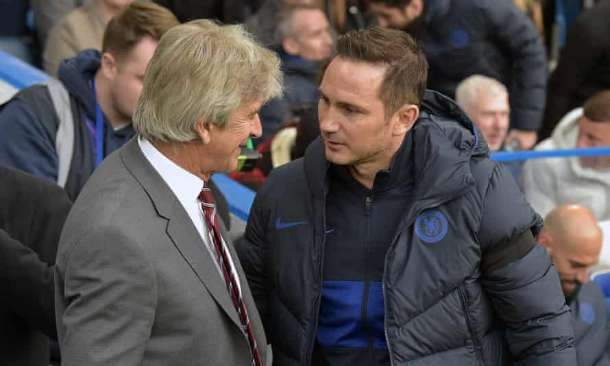 Manuel Pellegrini greets Frank Lampard of Chelsea prior to the match between Chelsea and West Ham