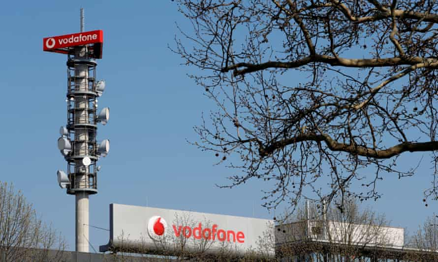 Different types of 4G, 5G and data radio relay antennas for mobile phone networks are pictured on a relay mast operated by Vodafone in Berlin, Germany