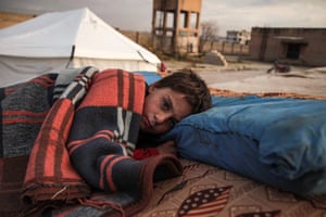 A child, who fled from regime forces advancing on Maaret al-Numan, in southern Idlib, rests at a refugee camp in Dana.