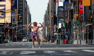 Street performer Robert John Burck, known as The Naked Cowboy poses at Times Square on May 15, 2020 in New York City. Pandemic lockdown measures in New York City have been extended until June 13 under an executive order signed by state Governor Andrew Cuomo late May 14, 2020.