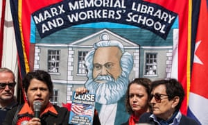 A Marx Memorial Library flag is flown at a May Day rally in London.