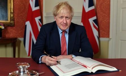 Boris Johnson signs the European Union withdrawal agreement.