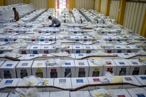 Officials prepare ballot boxes for distribution to polling station a day before the election on April 16, 2019 in Jakarta.
