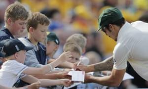 Signing autographs at tea