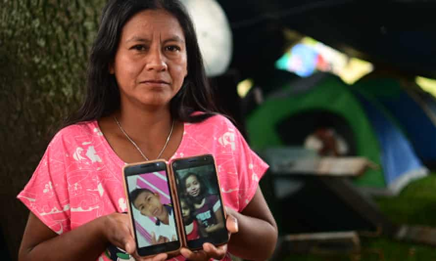 Luzmery Troches with pictures of her son Luis and his sister.