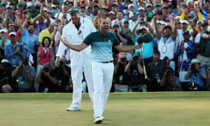Sergio Garcia and caddie Glen Murray celebrate after making his birdie putt on the 18th green to win the Masters.