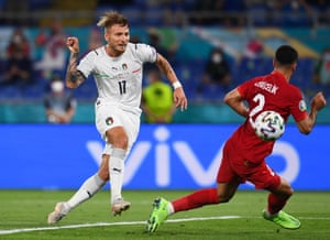 Ciro Immobile of Italy scores their second goal.