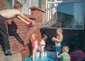 Cousins (from left) Corbun, Krystal, Poppie, Antony, Cody in the back yard of Mark's house in Darwen, June 2018