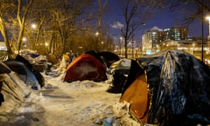 People sleep in tents near a wooded area adjacent to the Dan Ryan Expressway in Chicago on Tuesday.