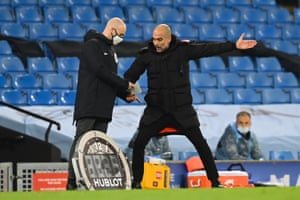 Pep Guardiola argues with fourth official Anthony Taylor.