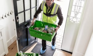 Waitrose delivery man enters home with crate of groceries