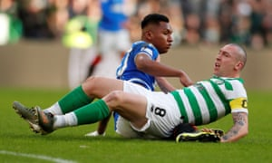 Celtic's Scott Brown with Rangers' Alfredo Morelos, whose mistranslated comments wrongly accused Celtic fans of racially abusing him.