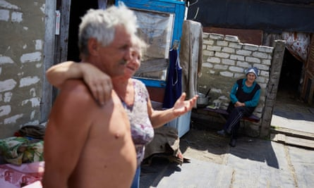Luhansk residents Vladimir, Olga and 90-year-old Nina, in the background.
