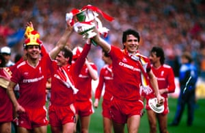 Liverpool players Jim Beglin (left) and Alan Hansen parade the FA Cup trophy.