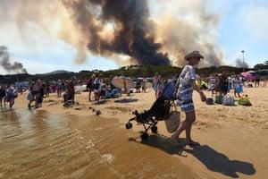 Bormes-les-Mimosas, France People leave a beach