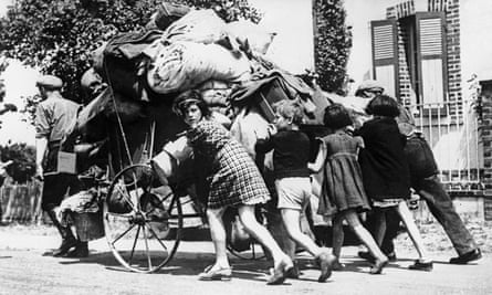 French civilians flee advancing German forces in June 1940.