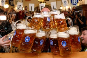 Munich, Germany: Matthias Voelkl carries 29 beer mugs