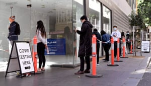 People queue up for Covid-19 testing in Melbourne on May 12, 2021, after a man tested positive to Covid-19 in the first community case in the city for two months.