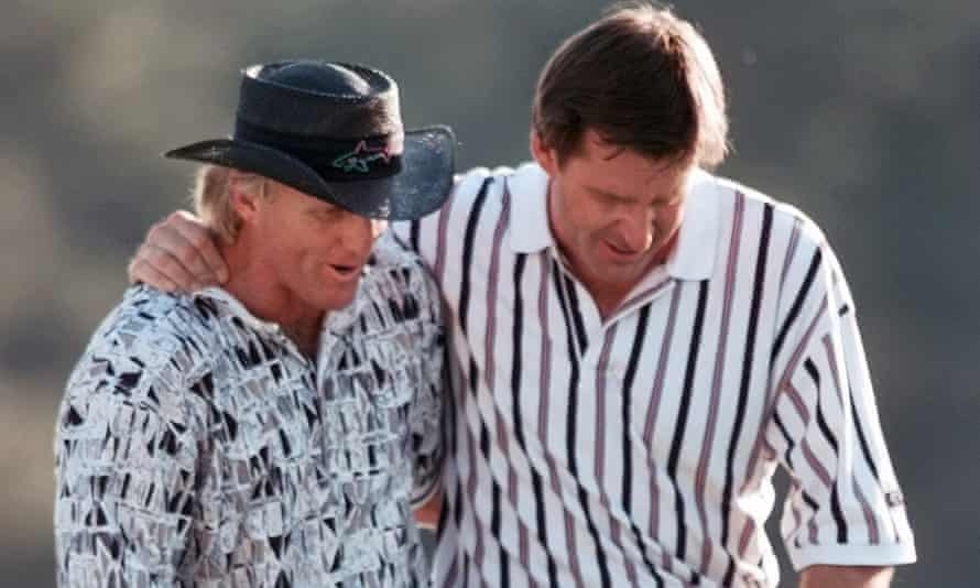 Greg Norman with Nick Faldo on the 18th at Augusta in 1996, after the Australian's final-round collapse helped the Englishman win his third Masters.