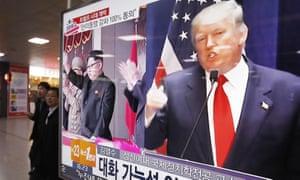 Donald Trump and Kim Jong-un flash up on television screens at Seoul railway station last week.