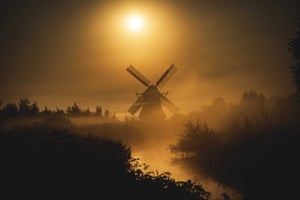 A mill appears in the morning mist in Groningen, the Netherlands