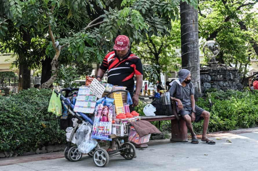 Jose Quizon built the push cart that now carries his home and livelihood from scrap materials