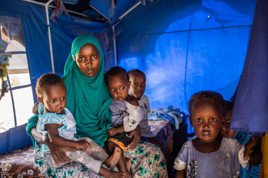 Hani Hashi Aden, 40, sits with her children in her makeshift home in the Xidig IDP camp in Mogadishu.