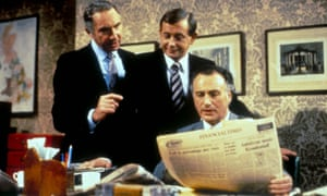 Sir Humphrey (left) and his junior Bernard Woolley enlighten PM Jim Hacker in a scene from Yes, Prime Minister ...