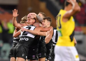 Port Adelaide celebrate victory over Richmond.