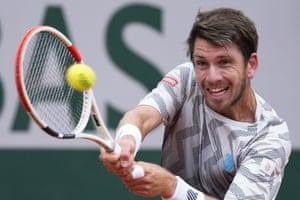 Cameron Norrie plays a return to Rafael Nadal.