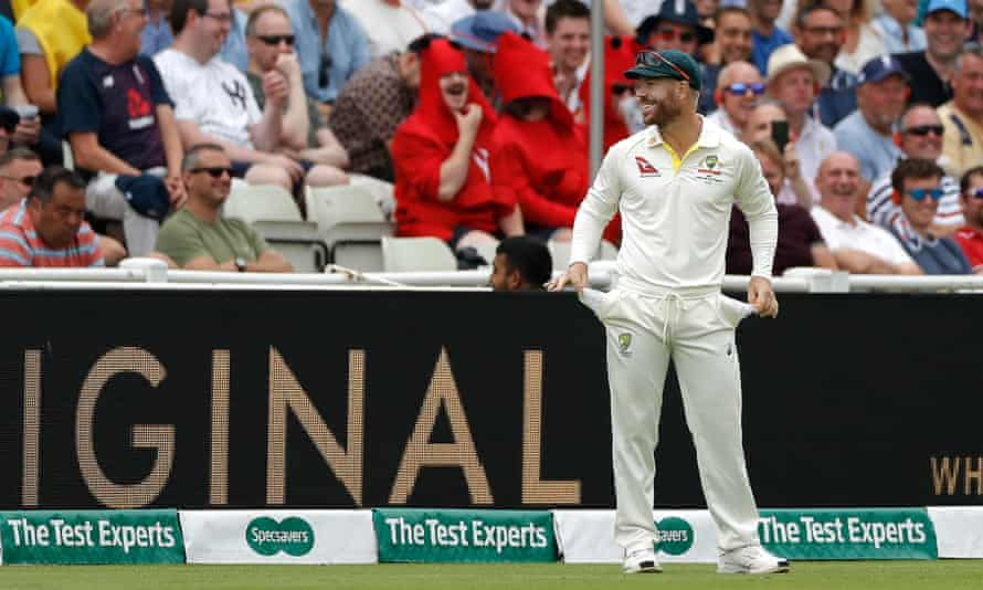 David Warner shows the Edgbaston crowd his empty pockets in a good-natured retort to some sandpaper barracking on day three of the first Test.